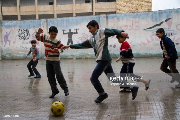 Children play in a school yard at an elementary school in Aleppo One of the first to reopen after the war started