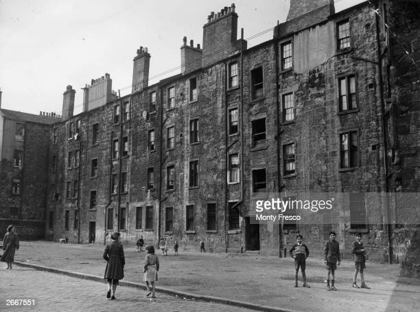 Children play in a yard in Coburg Street, in the Gorbals area of Glasgow. The Gorbals tenements were built quickly and cheaply in the 1840s,...