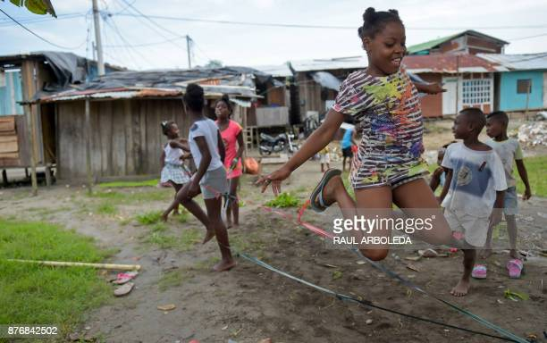 Children play in City 2000 a shantytown that is home to people displaced by turf wars between criminal gangs in Tumaco municipality Narino department...