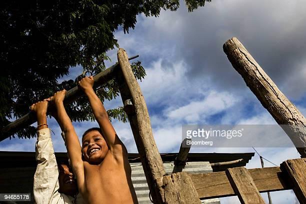Children play in Coche a poor hillside slum in Caracas Venezuela Wednesday November 29 2006 The poor neighborhoods surrounding Caracas are the base...