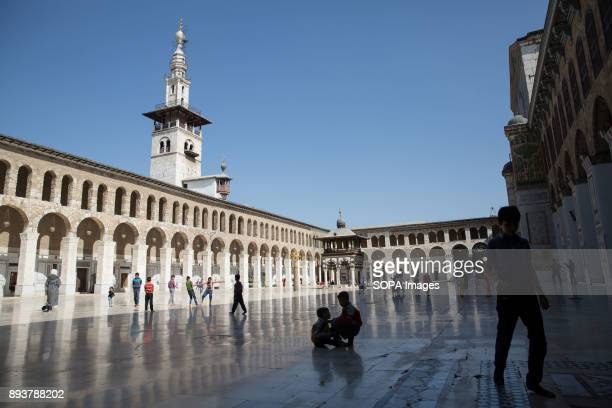 Children play in Damascus' Umayyad Mosque during Friday prayers Despite the ongoing conflict in Syria life in Damascus still carries on relatively...