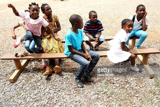 """Children play in front of the church of Mbalmayo on February 18, 2018 in Yaounde, Cameroon. Cameroon is often referred to as """"Africa in miniature""""..."""