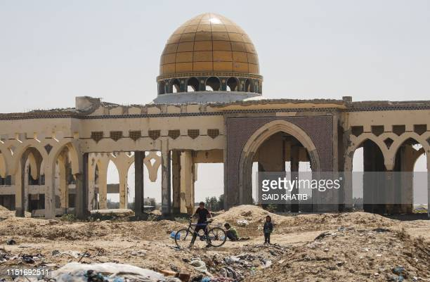 Children play in front of the destroyed and deserted terminal of the Gaza Strip's former Yasser Arafat International Airport in the Palestinian...