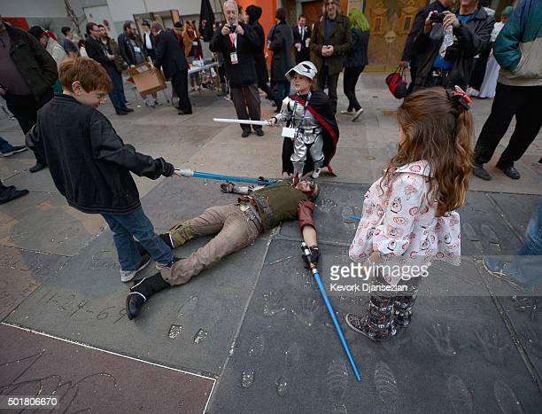 Children play in front of the TCL Chinese Theatre before the opening night of Walt Disney Pictures and Lucasfilm's Star Wars The Force Awakens at TCL...
