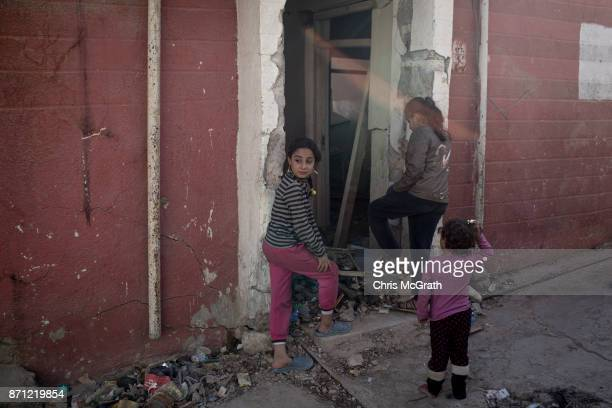 Children play in front of their destroyed home in West Mosul on November 3 2017 in Mosul Iraq Five months after Mosul Iraq's secondlargest city was...
