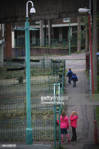 Children play in front of their homes on the Falinge Estate which has been surveyed as one the most deprived areas in England for five years in a row...