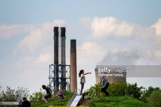 Children play in park against the backdrop of British Steel's Scunthorpe works which has been forced into liquidation today on May 22, 2019 in...