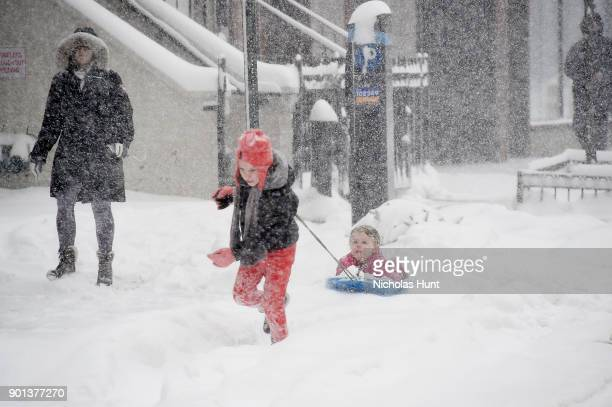 Children play in snow during a massive winter storm on January 4 2018 in New York City As a major winter storm moves up the Northeast corridor New...