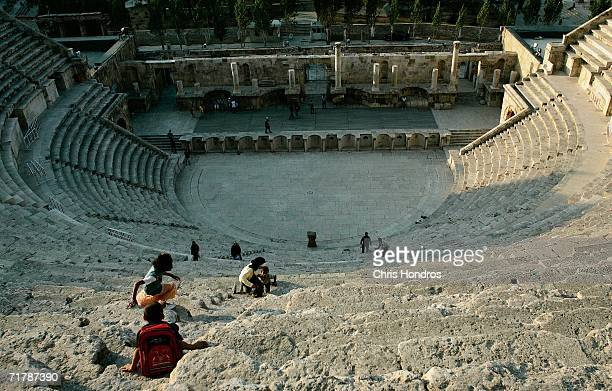 Children play in the ancient Roman ampitheatre August 19 2006 in downtown Amman Jordan Two gunmen fired at a group of foreign tourists in the...