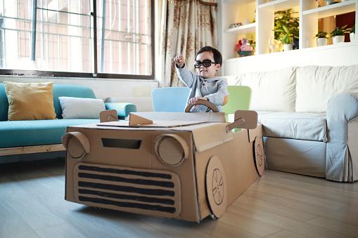 Children play in the cardboard car - gettyimageskorea