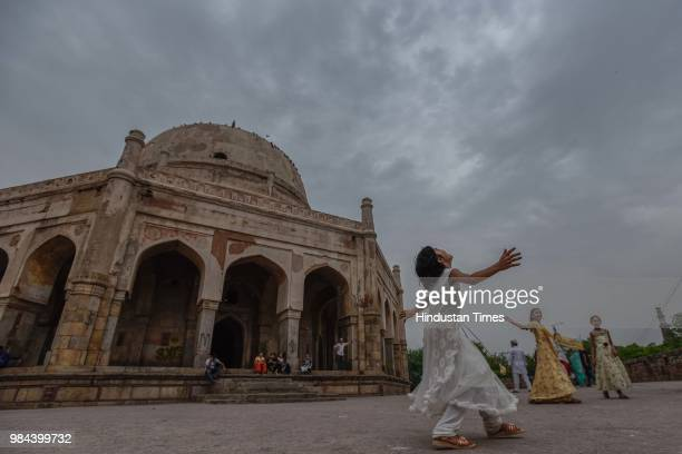 Children play in the compound of Adham Khan's Tomb in Mehrauli as dark clouds hover over the city on June 26 2018 in New Delhi India Temperature...