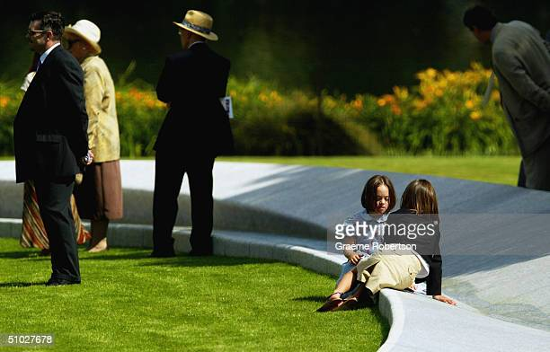 Children play in the fountain as HM Queen Elizabeth II and most of the Royal Family together with the Spencer family attend the opening of the Diana...