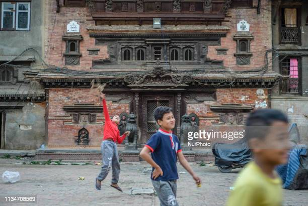 Children play in the inner yard in Thamel Kathmandu Nepal on April 3 2019