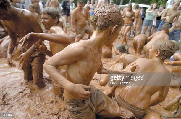 Children play in the mudpit during the Seventh Annual Summer Redneck Games on July 6, 2002 in East Dublin, Georgia. Thousands of people flock to the...