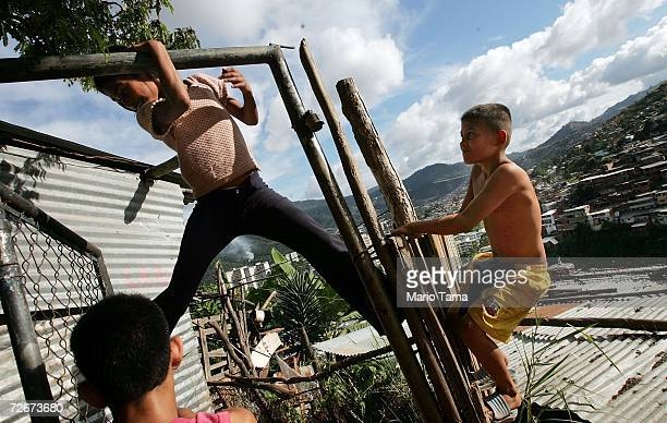 Children play in the poor barrio of Coche November 29 2006 in Caracas Venezuela Despite daily problems with fresh water and electricity residents of...