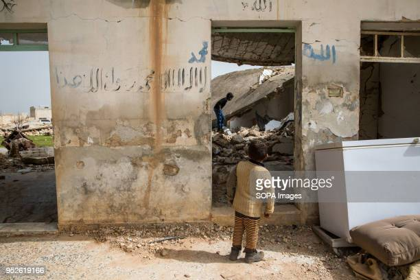 Children play in the rubble of an empty home they resettled after being displaced from the conflict in Afrin An estimated 400000 refugees fleeing the...