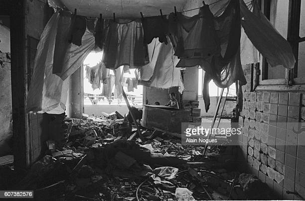 Children play in the ruins of the apartment where they still live The ruins testify to the intense fighting going on in the city since June 1982 as a...