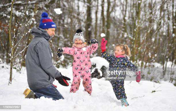 Children play in the snow on December 29, 2020 in Newcastle-Under-Lyme, England. Heavy snow fall has covered the West Midlands as the Met Office has...