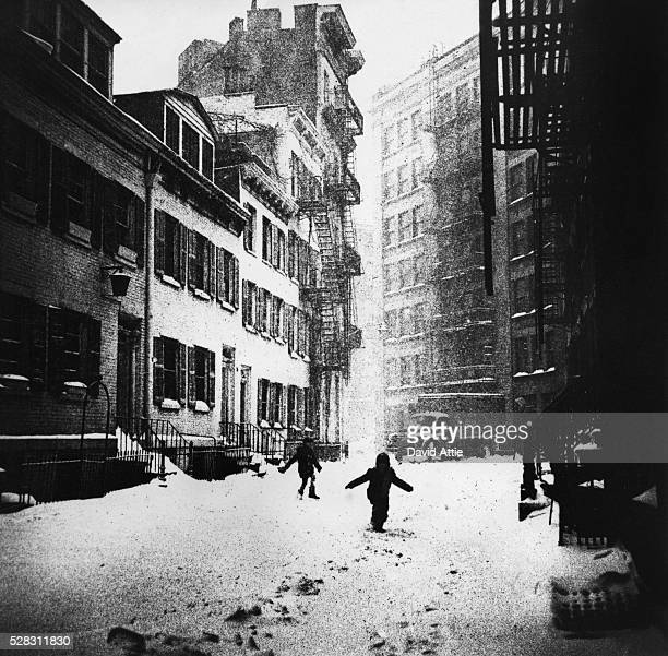 Children play in the snow on Gay street in Greenwich Village in 1960 in New York City New York