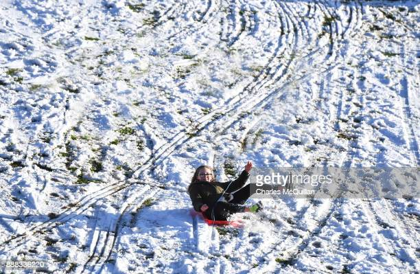 Children play in the snow on the slopes at Stormont on December 8 2017 in Belfast Northern Ireland The MET Office has issued a weather warning across...