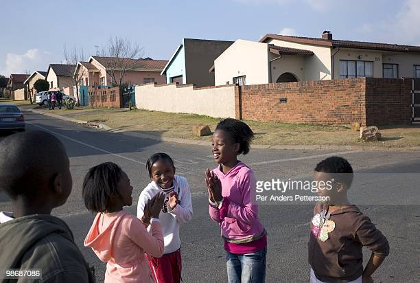 Children play in the street on July 13 2008 in Diepkloof a posh section of Soweto South Africa Soweto is the country's biggest township and the...