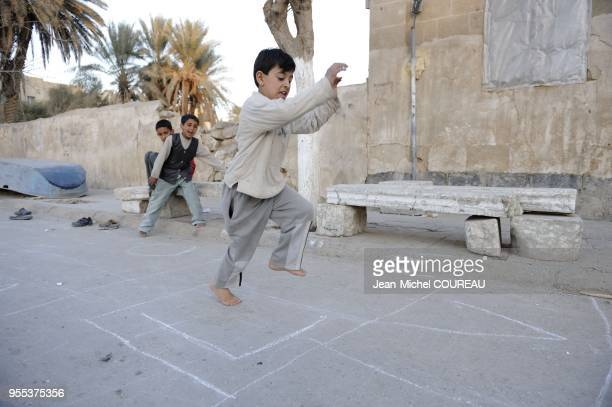 Children play in the streets of Deir es Zor in a game similar to the hopscotch