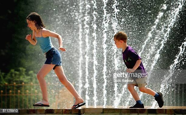 Children play in the sun at Battersea Park on June 29 2004 in London England Parts of the United Kingdom are set for soaring temperatures this...