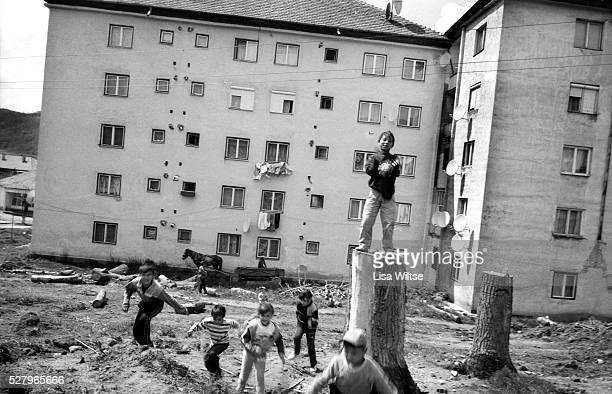 Children play in the towering Soviet style housing estates in the polluted town of Copsa MicaRomania May 19 2008The town is known for its status as...