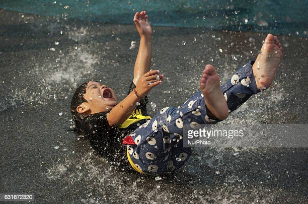 Children play in the water during the National Children's Day event inside children's museum in Bangkok Thailand on 14 January 2017