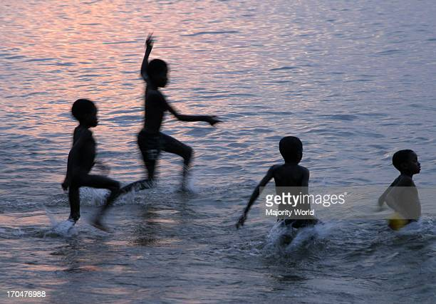 Children play in the waters of Lake Malawi Malawi