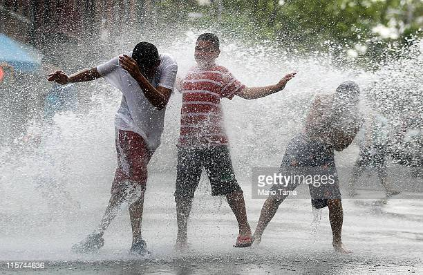 Children play in water sprayed from a fire hydrant on June 9 2011 in the Bronx borough of New York City An early summer heat wave has hit the city...