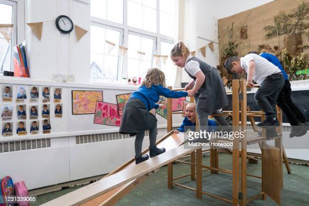 Children play indoors at Roath Park Primary School on February 23, 2021 in Cardiff, Wales. Children aged three to seven began a phased return to...