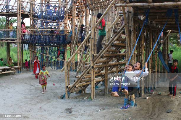 Children play inside the bamboo play space in Dhaka The unique play space built in Dhaka has brought smiles on the faces of local and underprivileged...