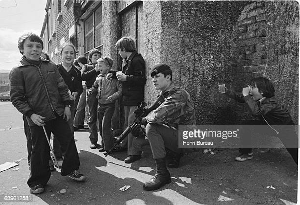 Children play near a British soldier one day before the death of Provisional Irish Republican Army leader Bobby Sands