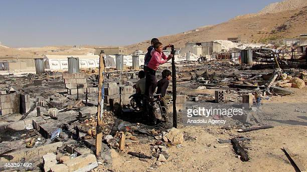 Children play near a destroyed building after clashes between Lebanon army and armed groups in Arsal of Lebanon a town on the border with wartorn...