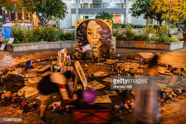Children play near a mural of Breonna Taylor on September 17, 2020 in Louisville, Kentucky. Protestors continue to gather to celebrate the life of...