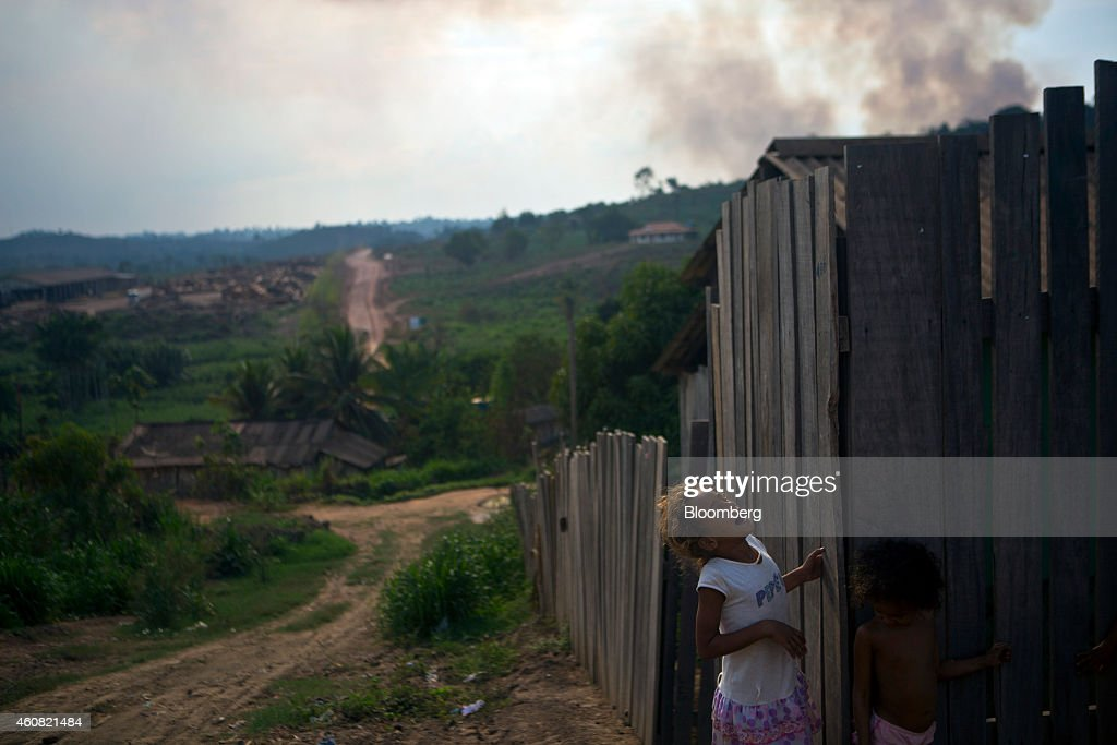 Children play near a sawmill in Anapu, Brazil, on Thursday, Dec. 18, 2014. The rate of deforestation Brazil's Amazon rain forest dropped 18 percent over the last year, according to a report by the country's environment minister in November. Photographer: Dado Galdieri/Bloomberg via Getty Images