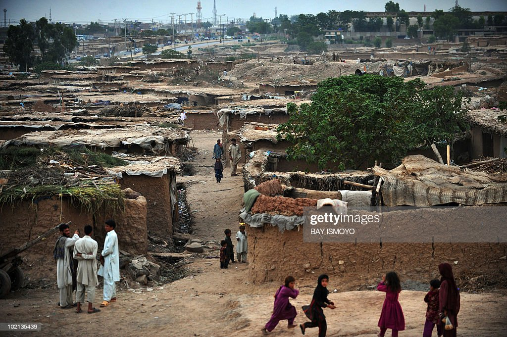 Children play near a slum area in Islamabad on June 15, 2010. Pakistan approached the International Monetary Fund in 2008 and has secured a 11.3 billion USD standby loan in an effort to contain inflation and cope with a rapid depletion of reserves that were barely enough to cover nine weeks of import bills. AFP PHOTO / Bay ISMOYO