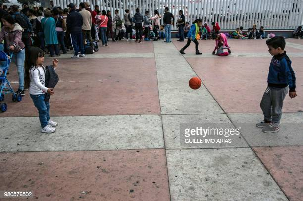 Children play near El Chaparral port of entry in Tijuana Mexico in the boder with the United States on June 21 2018 US lawmakers were poised to vote...