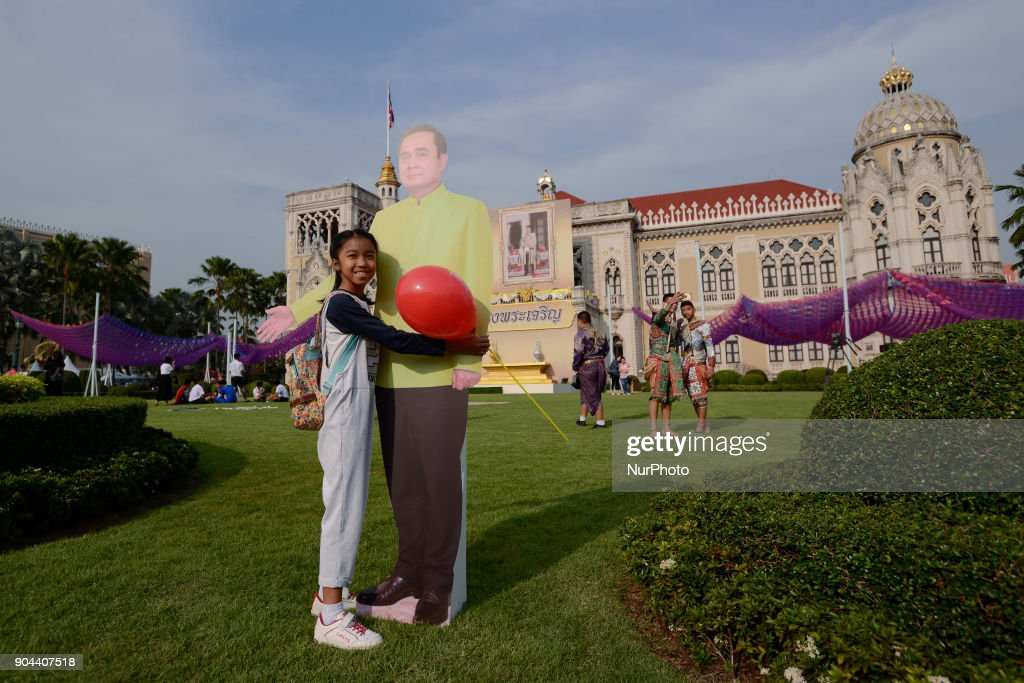 Children play next to a cardboard cutout of Thailand's Prime Minister Prayuth Chan-ocha during the Children's Day celebration at Government House in Bangkok, Thailand, January 13, 2018.
