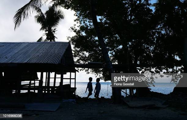 Children play next to a house on the shores of the lagoon on August 15 2018 in Funafuti Tuvalu The small South Pacific island nation of Tuvalu is...