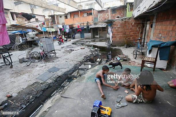 Children play next to sewage running through a formerly deserted building which is currently home to dozens of families who occupy the building in...