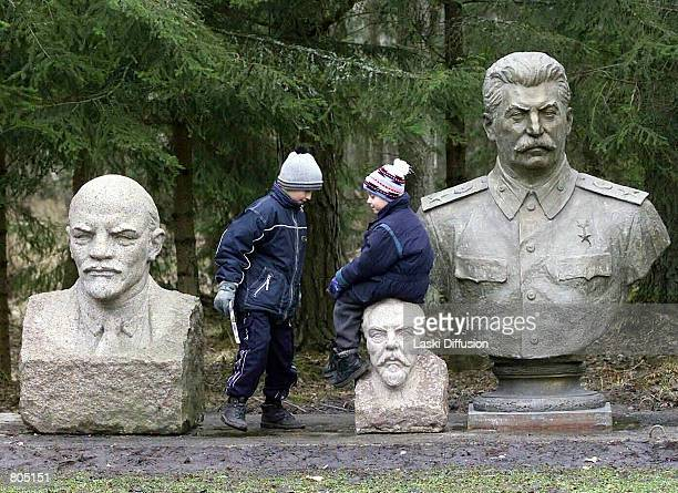 Children play next to the busts of former dictators Vladimir Lenin and Josef Stalin at the Soviet Sculpture Garden dubbed 'Stalin World' in the...