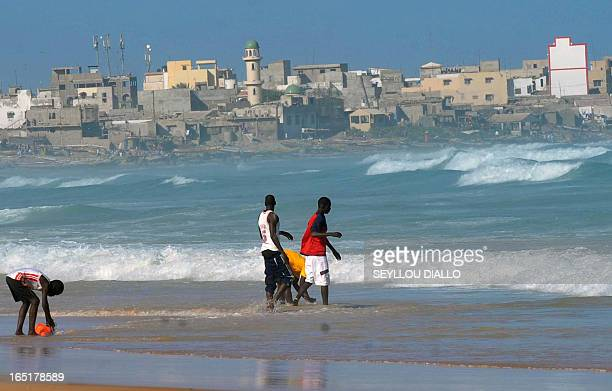 BOUTREUX Children play on a beach in Dakar on January 7 2011 Dakar prosecuters have received five complaints against illegal constructions on the...