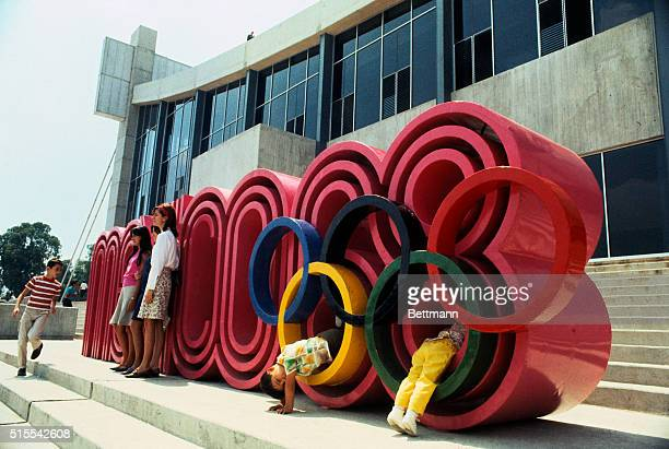 Children play on a big concrete insignia reading 'Mexico 68' with the Olympic circles superimposed Such decor is common in Olympic Village and...
