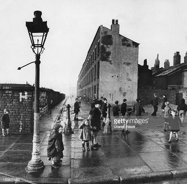 Children play on a bomb site in a poor area of Liverpool before Rodney Youth Centre opens for the day February 1949 The centre was organised to...