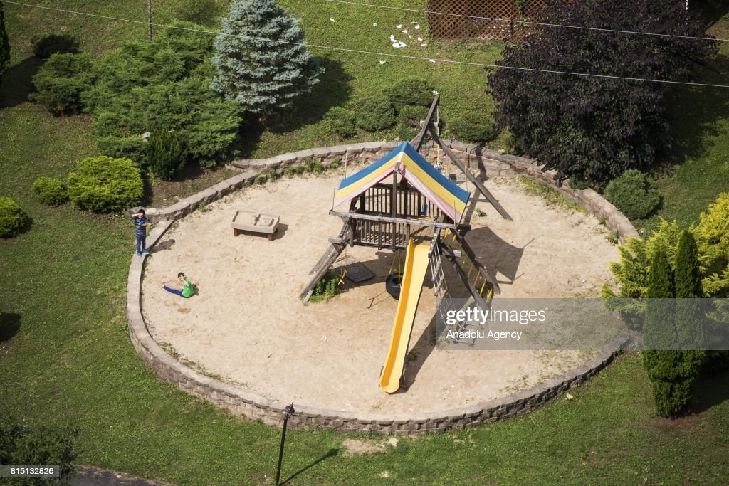 Children play on a playground at the Fetullah Terrorist Organization (FETO) compound where Fetulah Gulen resides in Saylorsburg, PA., United States on July 15, 2017. 249 people were martyred and nearly 2,200 people injured in the defeated 15th of July 2016 coup attempt, which the Turkish government said was carried out by the Fetullah Terrorist Organization (FETO) led by U.S.-based Turkish citizen Fetullah Gulen. Turkish officials accuse Fetullah Gulen plotting to overthrow the government of President Erdogan as the culmination of a long running campaign to infiltrate Turkish institutions including the military, the police and the judiciary.
