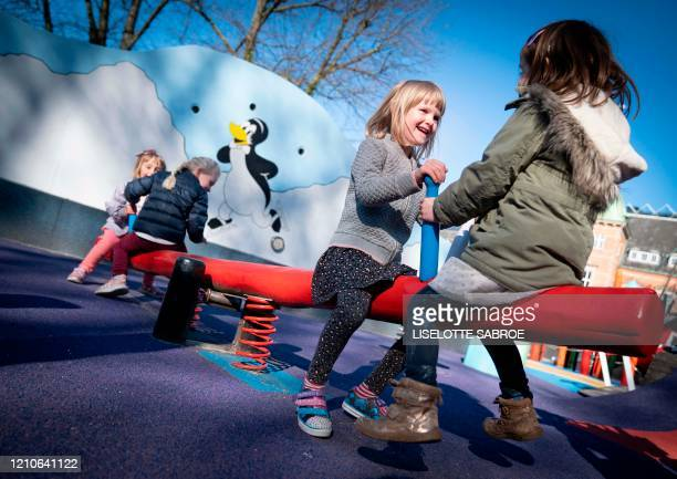 Children play on a playground of the Tivoli Gardens in Copenhagen on April 22 amid the new coronavirus COVID19 pandemic Due to the lack of space...