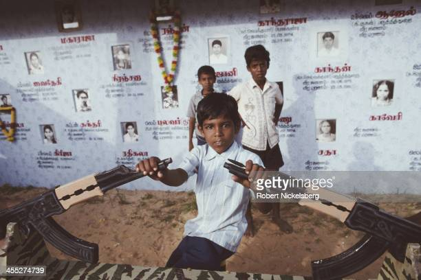 Children play on a seesaw in Martyr's Park Point Pedro Jaffna District Sri Lanka January 1992