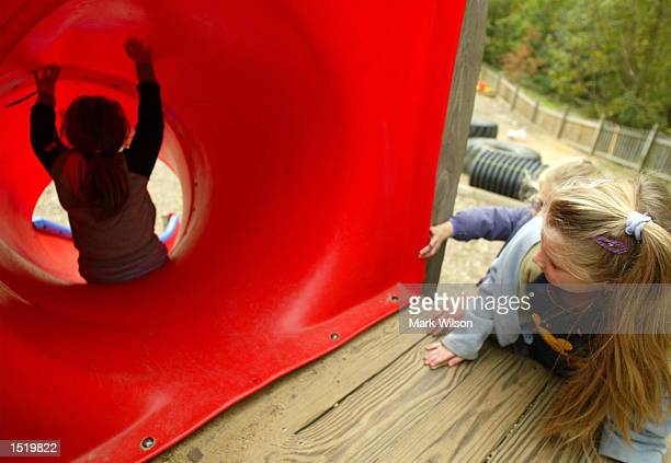 Children play on a slide at a Maryland school playground October 25 2002 in Huntingtown Maryland With the Code Blue lifted for Washington area...